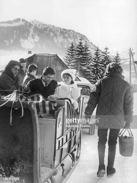 Young Newlyweds Sacha Distel And The Skiing Champion Francine Breaud Pictured Seated In A Sled Upon Leaving The Church Where Their Wedding Ceremony...