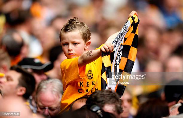 A young Newport fan holds up a flag during the Blue Square Bet Premier Conference Playoff Final match between Wrexham and Newport County AFC at...