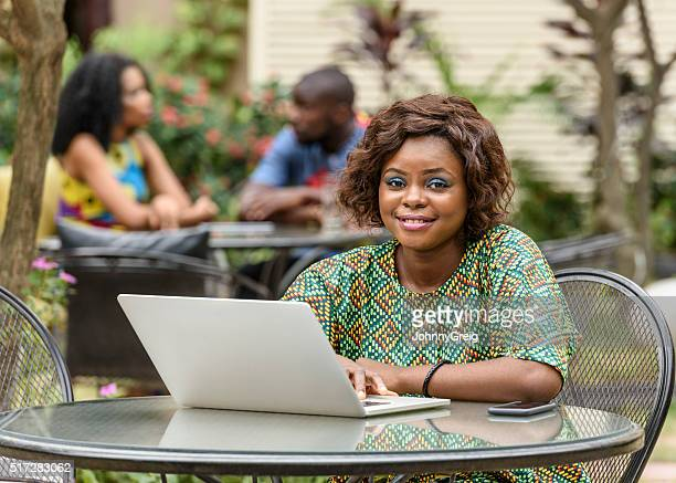 Young Nigerian woman using laptop computer