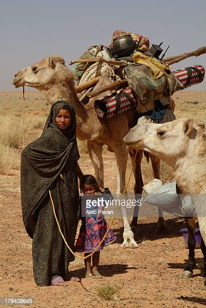 Young nomad woman with child during transhumance