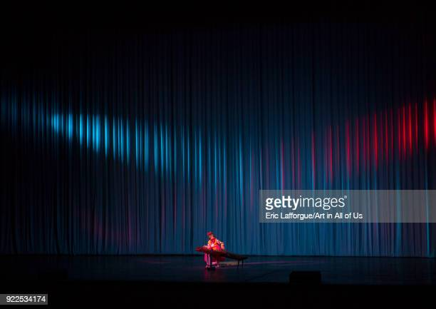 Young North Korean artist playing kayagum on stage in Mangyongdae children's palace Pyongan Province Pyongyang North Korea on September 13 2012 in...