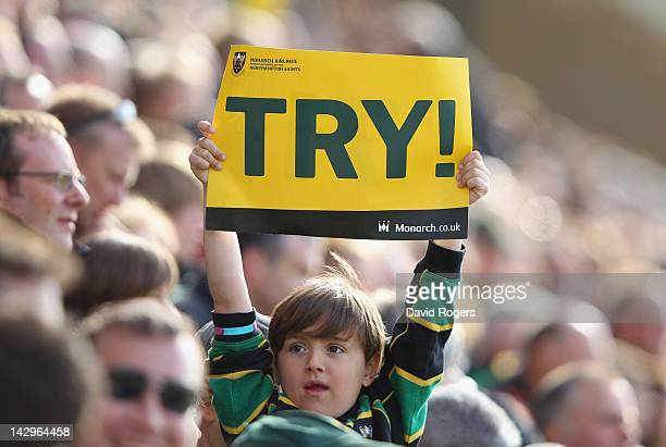 Young Northampton fan celebrates a try during the Aviva Premiership match between Northampton Saints and Leicester Tigers at Franklin's Gardens on...