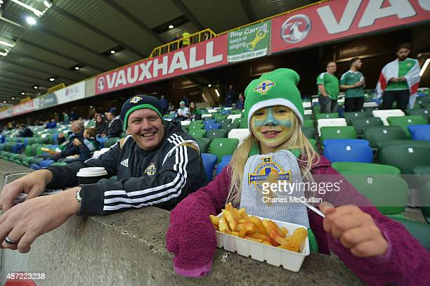 A young Northern Ireland fan enjoys some chips before the Euro 2016 Group F qualifying match between Northern Ireland and Hungary at Windsor Park on...