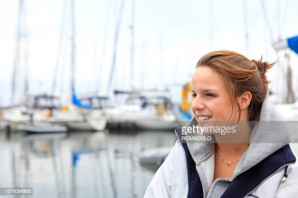 Young Norwegian woman at the marina