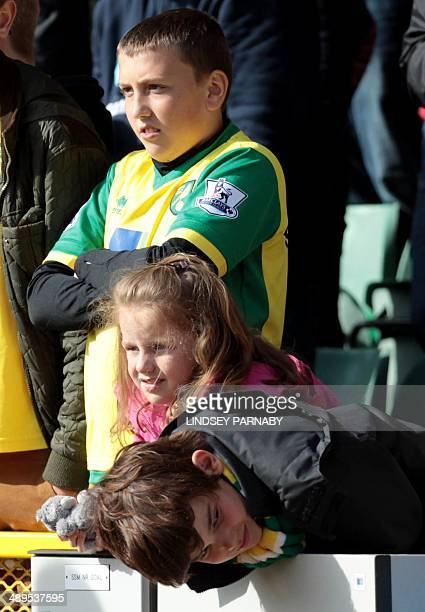 Young Norwich City fans show dejection after the English Premier League football match between Norwich City and Arsenal at Carrow Road in Norwich on...