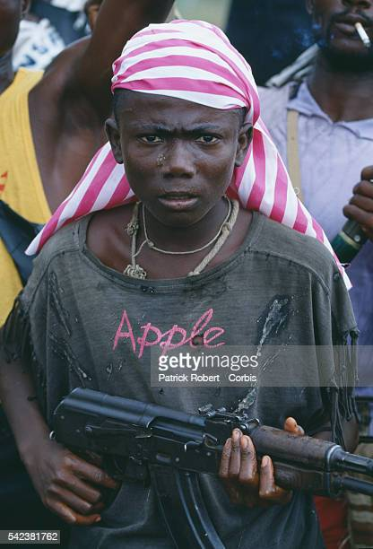 A young NPFL rebel brandishes an assault rifle in Monrovia during the Liberian Civil War In 1989 Charles Taylor leader of the NPFL launched a revolt...