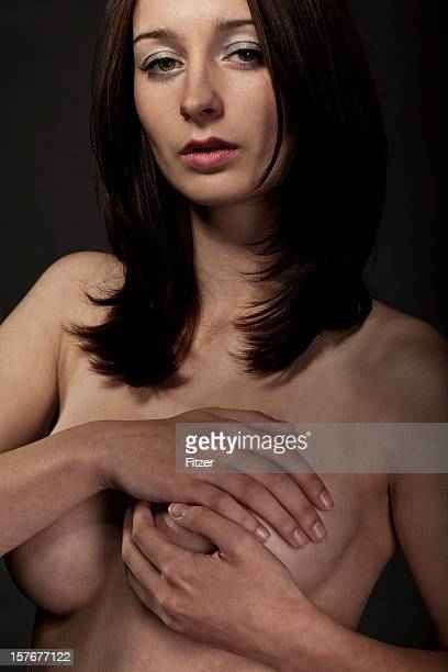 young nude woman indoor, black background