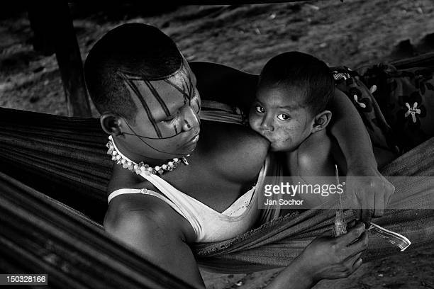 A young Nukak mother feeds her baby while lying in a hammock in a refugee camp close to San Jose del Guaviare on September 04 2009 in San Jose del...