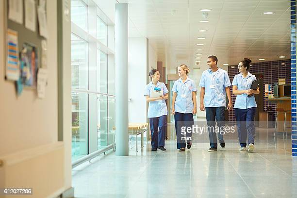 young nurses on their way to ward - tunic stock pictures, royalty-free photos & images