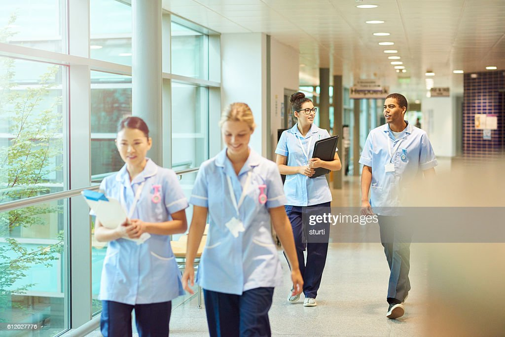 young nurses on their way to ward : Stock Photo