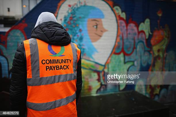 Young offenders do manual work erecting a flower display box as part of a Community Payback Scheme on February 26 2015 in Manchester United Kingdom...