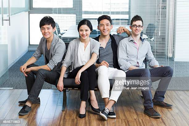 Young office workers sitting in sofa
