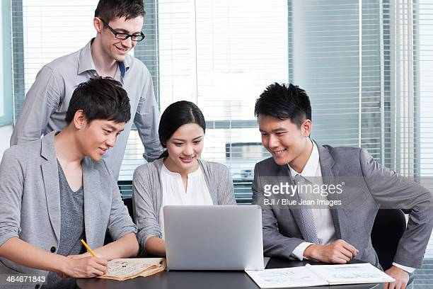 Young office workers using laptop