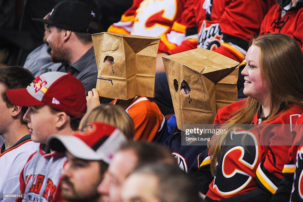 Young Oilers fan wear paper bags over their heads during an NHL game against the Calgary Flames at Scotiabank Saddledome on January 31, 2015 in Calgary, Alberta, Canada. The Flames defeated the Oilers 4-2.