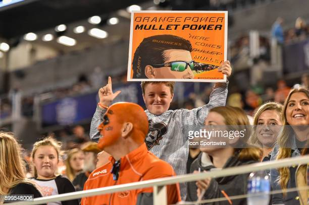 A young Oklahoma State fan holds up a sign to support Oklahoma State Cowboys head coach Mike Gundy's mullet during the first half of the Camping...