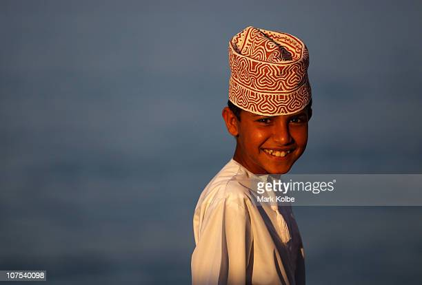 A young Omani boy smiles at AlMusannah Sports City during day five of the 2nd Asian Beach Games Muscat 2010 on December 12 2010 in Muscat Oman