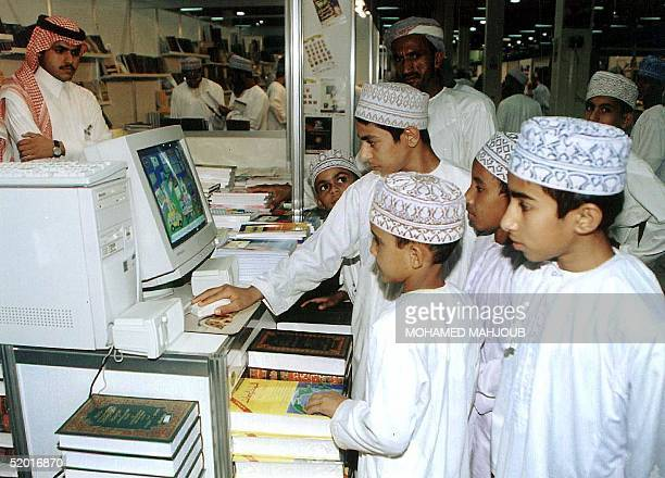 Young Omani boys play computer games at a display 24 February on the last day of the Muscat International Book Fair
