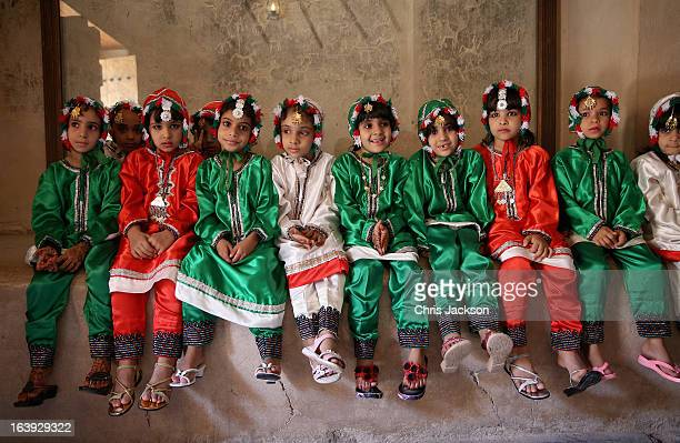 Young Omani children wait in the shade before greeting Prince Charles Prince of Wales and Camilla Duchess of Cornwall visit Nizwa Fort on the eighth...