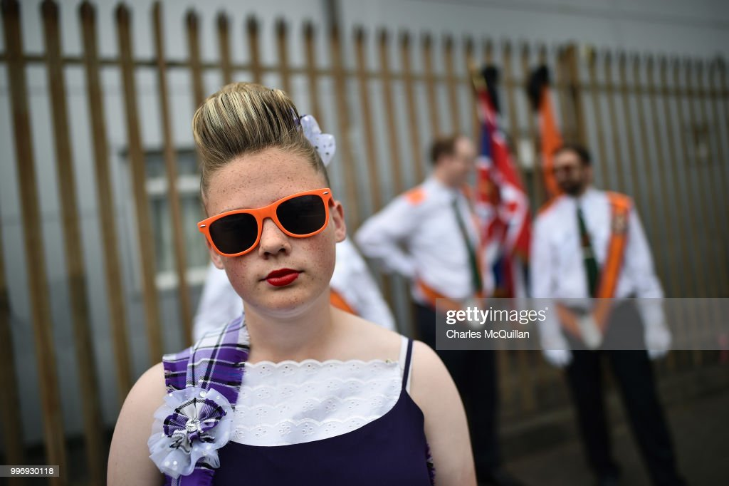 A young Orange band member watches on during the annual 12th of July Orange march and demonstration takes place on July 12, 2018 in Belfast, Northern Ireland. The marches across the province celebrate King William of Orange's victory over the Catholic King James at the Battle of the Boyne in 1690.