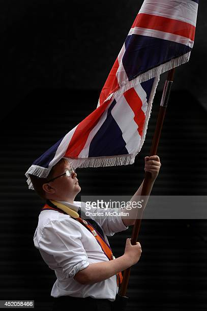 A young Orange bandsman pauses for a moment during Northern Ireland's annual 12th of July march as it made it's way through Belfast city centre on...
