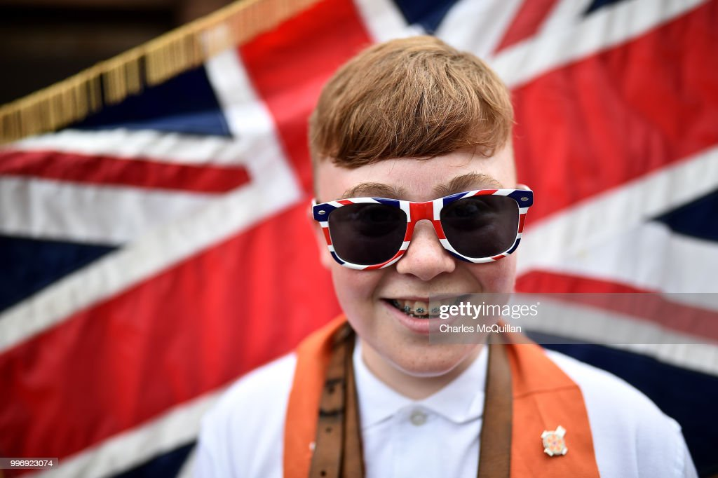 A young Orange man poses for a photograph during the annual 12th of July Orange march and demonstration taking place on July 12, 2018 in Belfast, Northern Ireland. The marches across the province celebrate King William of Orange's victory over the Catholic King James at the Battle of the Boyne in 1690.