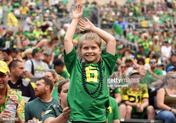 A young Oregon Ducks fan supports her team during a college football game between the Southern Utah Thunderbirds and Oregon Ducks on September 2 at...