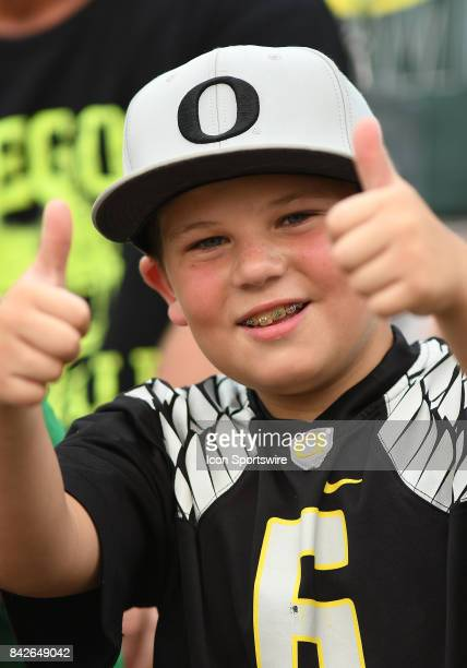 A young Oregon Ducks fan supports his team during a college football game between the Southern Utah Thunderbirds and Oregon Ducks on September 2 at...