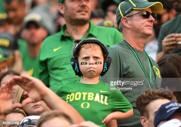 A young Oregon Ducks fan watches pregame festivities during a college football game between the Southern Utah Thunderbirds and Oregon Ducks on...