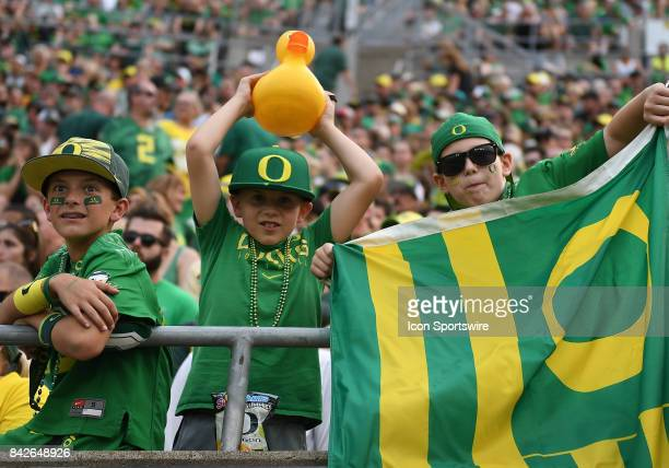 Young Oregon Ducks fans show their support during a college football game between the Southern Utah Thunderbirds and Oregon Ducks on September 2 at...