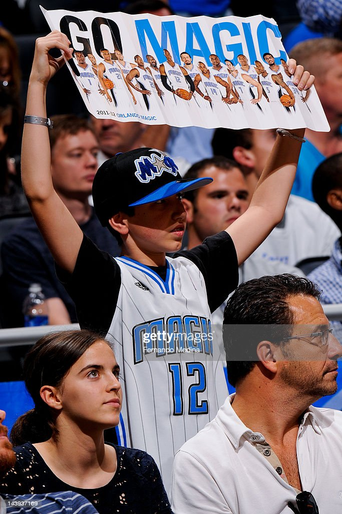 A young Orlando Magic fan cheers on his team against the Indiana Pacers in Game Four of the Eastern Conference Quarterfinals during the 2012 NBA Playoffs on May 5, 2012 at Amway Center in Orlando, Florida.