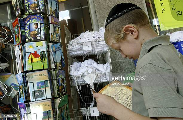 A young Orthodox Jewish boy reads a comic book at a shop in the Israeli town of Bnei Brak near Tel Aviv on October 29 2009 A far cry from the thrills...