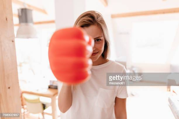 Young owman wearing red boxing glove