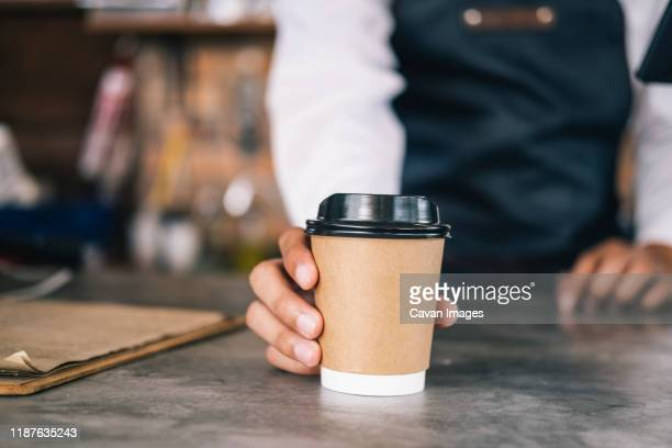 young owner of coffee cafe service customer. - take out food stock pictures, royalty-free photos & images