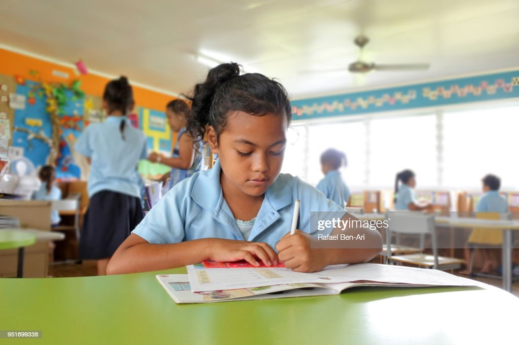 Young Pacific Islander girl study in school in Rarotonga Cook Islands : Stock Photo