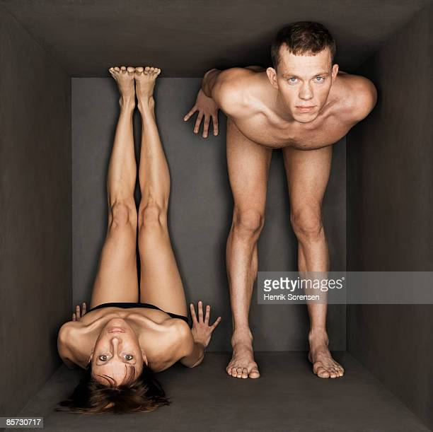 young pair trapped inside a small black room
