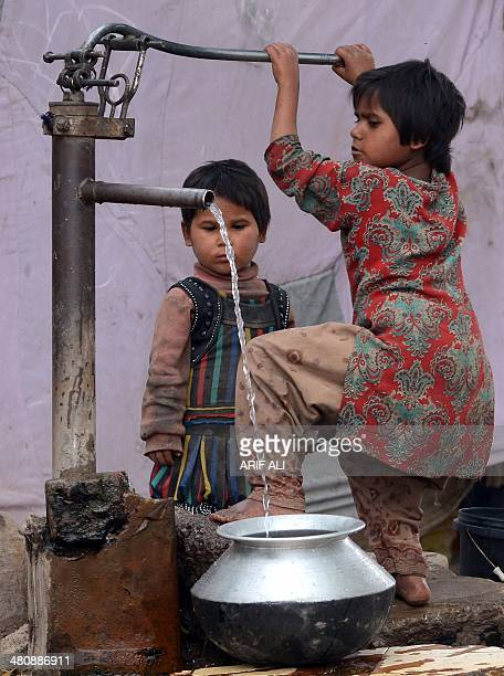 A young Pakistani girl fills a pot with water from a hand pump in Lahore on March 27 2014 More than 25 billion people are in need of decent...