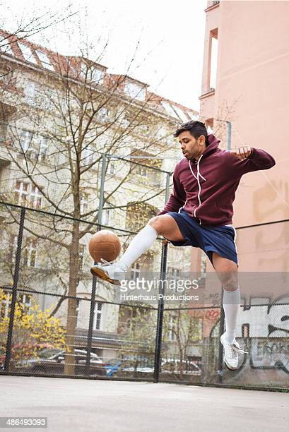 Young Pakistani Playing Urban Soccer