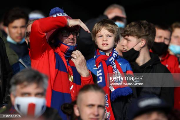 Young Palace fan with his father during the Premier League match between Crystal Palace and Arsenal at Selhurst Park on May 19, 2021 in London,...