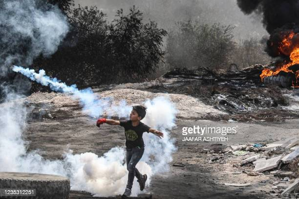 Young Palestinian boy joins fellow protesters in confrontations with Israeli security forces, following a demonstration against settlements in the...