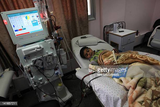A young Palestinian boy receives kidney dialysis at a hospital in Gaza City on March 21 2012 a day after the ministry of health in the Gaza Strip...