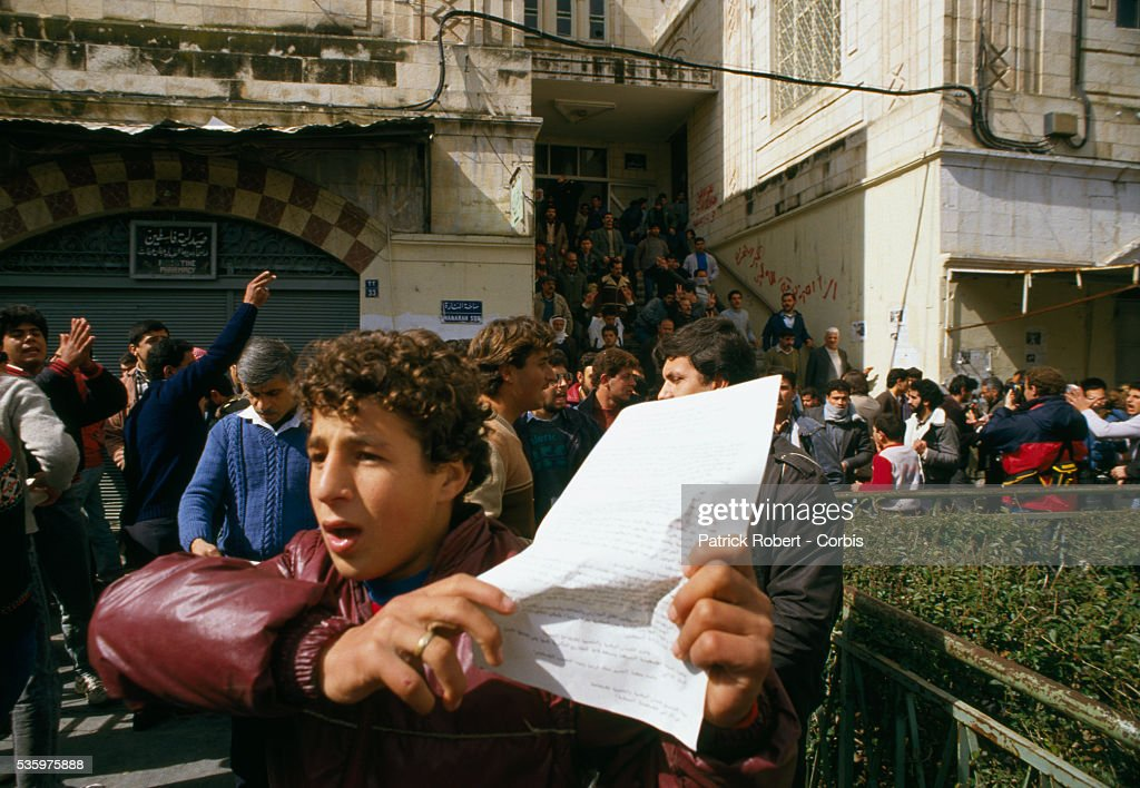 A young Palestinian demonstrator distributes leaflets in Nablus after the Friday Prayer. Violence broke out after rebel Israeli and Palestinian fighters protested in the disputed territory of West Bank during the first Intifada.