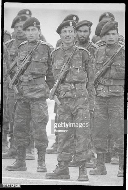 Young Palestinian guerillas with their AK47 slung on their chests stand at attention as Yasser Arafat addresses PLO guerillas at this training camp...