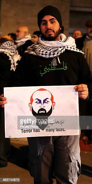 A young Palestinian man holds up a poster during a vigil in the West Bank city of Beit Sahur Following another video released by ISIS on Sunday which...