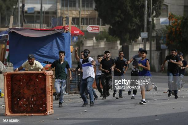 TOPSHOT Young Palestinian men clash with Israeli soldiers in the Amari refugee camp near Ramallah in the occupied West Bank after troops stormed the...