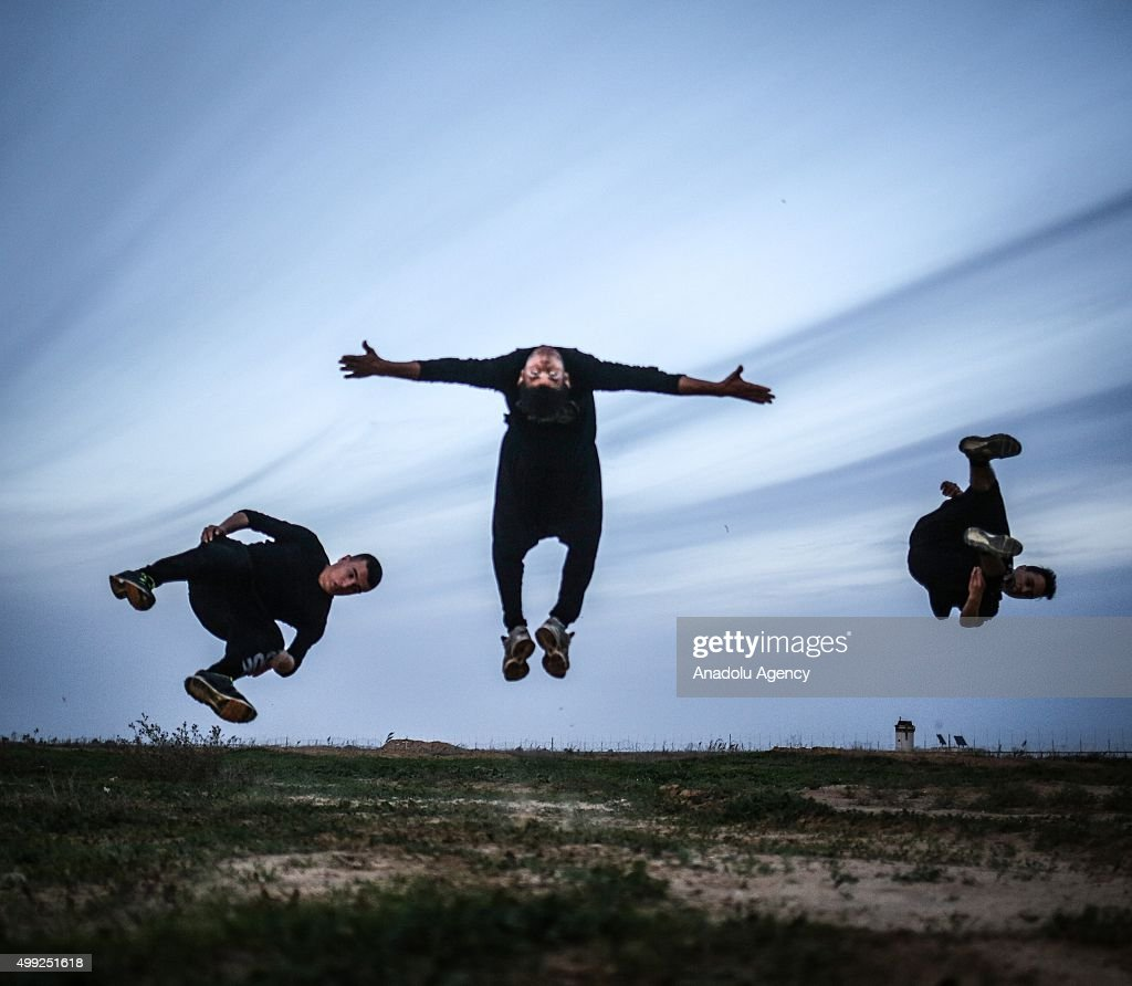Young Palestinians practice their parkour skills at Gaza-Israel border, despite all dangers due to ongoing conflicts, in Gaza City, Gaza on November 30, 2015.