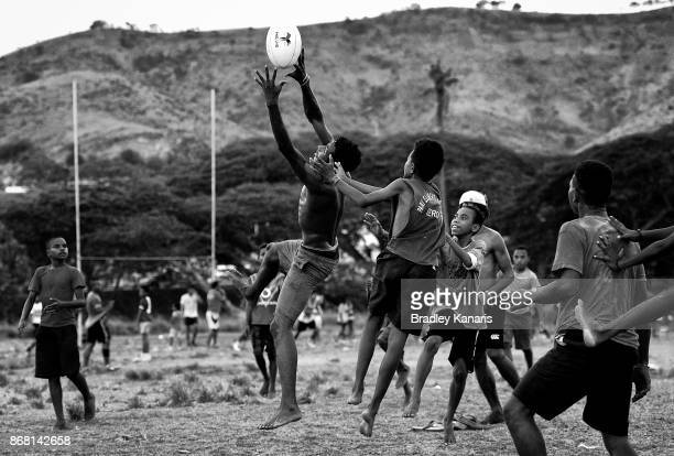 Young Papua New Guineans play Rugby League at a local park on October 30 2017 in Port Moresby Papua New Guinea Rugby League is the national sport of...