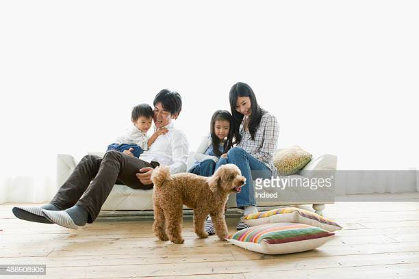 young parents and  their children who play in the room