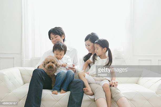 young parents and their children who sit together