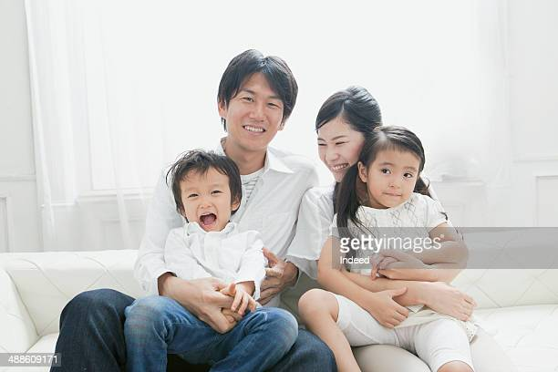 young parents and their children who sit together - japan photos stock photos and pictures