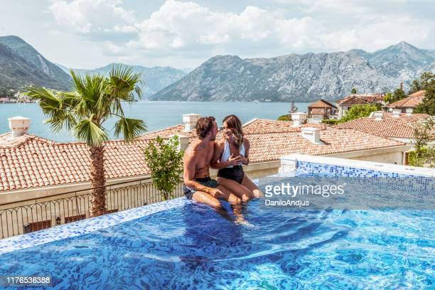 young parents having some time for themselfs by the pool - tourist resort stock pictures, royalty-free photos & images